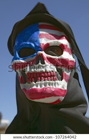 MARCH 2005 - Death mask with an American flag of the grim reaper at George W. Bush and anti-America protest in Tucson, AZ