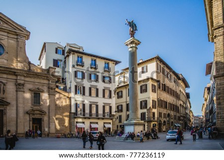 March 28, 2017 - Florence, Italy: People on square in front of Church of Santa Trinita in Florence #777236119