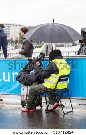 March 3, 2015 Marathon harmony in Geneva, Switzerland. people of different professions provide job marathon. photographer