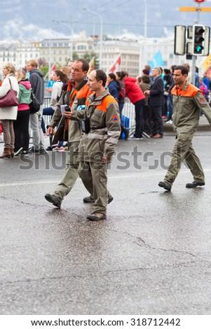 March 3, 2015 Marathon harmony in Geneva, Switzerland. people of different professions provide job marathon. assistance service, police, firefighters