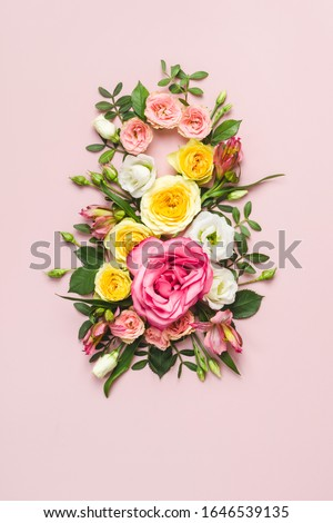 March 8th concept. Number 8 creative layout made of colorful rose flowers on pink background. Greeting Card Women's Day on March 8th.
