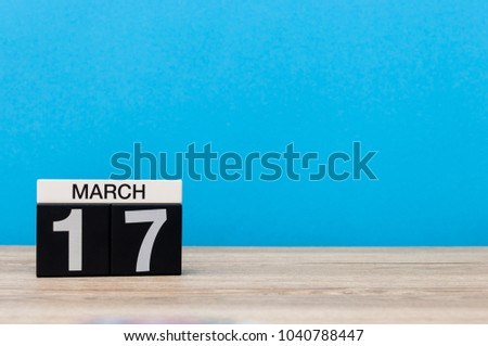 March 17th. Day 17 of march month, calendar on light blue background. Spring time, empty space for text, mockup