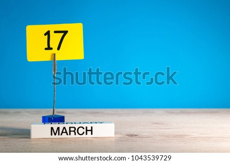 March 17th. Day 17 of march month, calendar on little tag at blue background. Spring time. Empty space for text, mockup