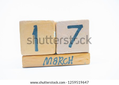 march 17th. Day 17 of month, handmade wood calendar isolated on white background. Spring month, day of the year concept