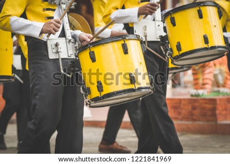 Marching band drummers perform in school parade