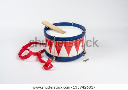 marching drum with sticks