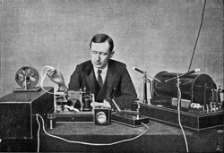 Marconi in front of his receiving device for wireless telegraphy, vintage engraved illustration. From the Universe and Humanity, 1910.