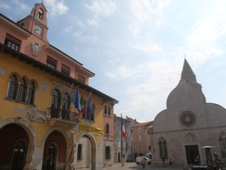 Marconi Square in Muggia : Town Hall and Gothic Cathedral of Saints John and Paul.