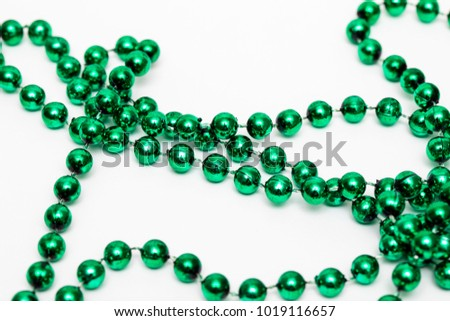Mardi gras beads necklace against a white background