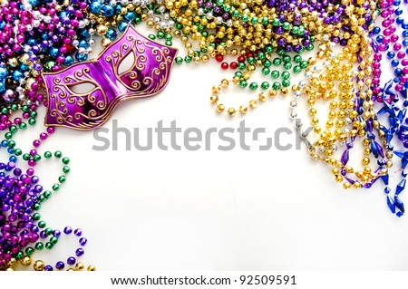 mardi gras mask and beads for party