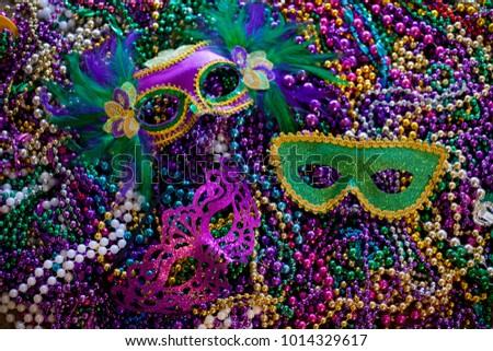 Mardi Gras Masks and Mardi Gras Beads Background