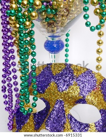 mardis gras beads and harlquin mask cropped tight for party background