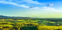 Maremma countryside, sunset landscape. Green fields and Elba island and sea on horizon. Tuscany, Italy, Europe.