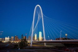 Margaret Hunt Hill Bridge and Dallas City skyline at twilight, Texas