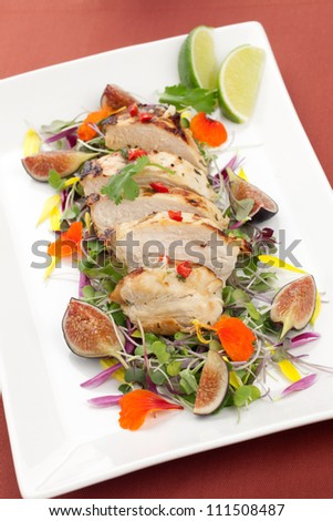 Margarita Chicken breast, grilled, over Micro Greens salad with edible flowers and black figs.