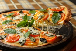 Margarita pizza with basil leaves