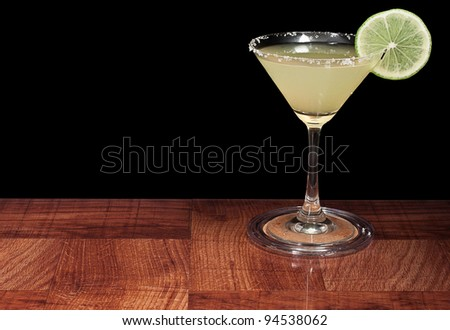 margarita served up on a bar top isolated on a black background