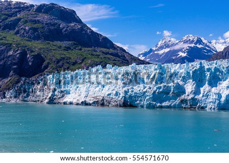 Margerie Glacier flows down out of the Alaskan Mountains into Glacier Bay. #554571670