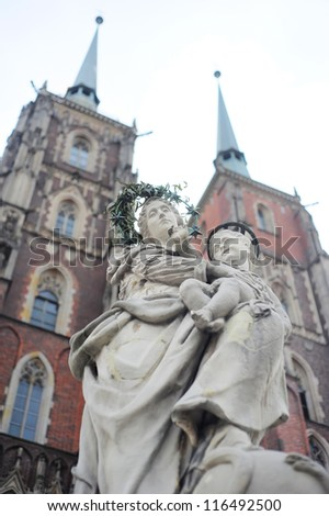 Maria & Child Jesus sculpture standing in front of St. John the Baptist's Cathedral in Wrocl?aw, Poland.