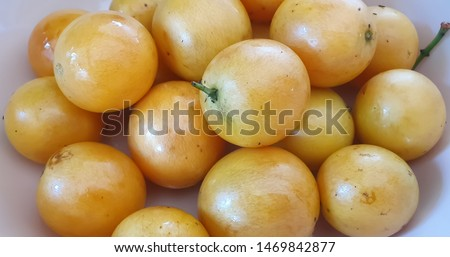 Marian Plum or mapang is a fruit in Thailand with sweet and sour taste.