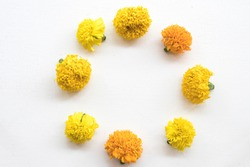 marigold yellow flower of asia arrangement circle style on background white wooden