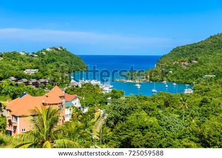 Marigot Bay, Saint Lucia, Caribbean. Tropical bay and beach in exotic and paradise landscape scenery. Marigot Bay is located on the west coast of the Caribbean island of St Lucia.