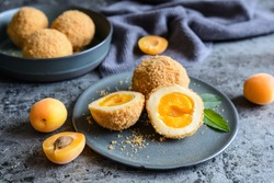 Marillenknödel – traditional Austrian sweet dumplings stuffed with apricot and coated with breadcrumbs
