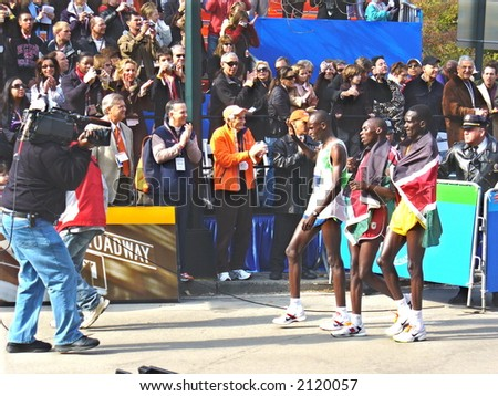 Marilson Gomes dos Santos of Brazil (first place), Stephen Kiogora of Kenya (second place) and Paul Tergat of Kenya (third place) celebrate at the 2006 ING New York City Marathon
