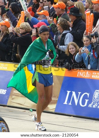 Marilson Gomes dos Santos of Brazil greets fans after finishing in first place in the 2006 ING New York City Marathon