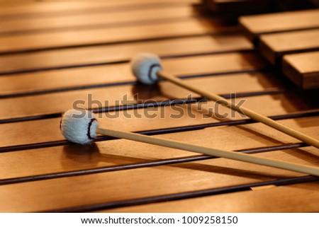 Marimba mallets on marimba. Percussion instrument