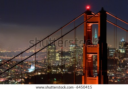 Marin tower of the Golden Gate Bridge with San Francisco in the background.