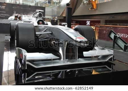 MARINA BAY SAND, SINGAPORE - SEPTEMBER 27: TAG HEUER Formula1 car presented at Marina Bay Sands on September 27,  2010 in Singapore