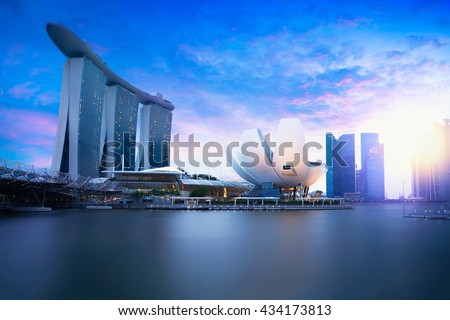 Marina bay Singapore at dusk, Singapore city skyline. Officially the Republic of Singapore