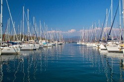 Marina boat masts and reflections on a sunny summer day blue sea in Fethiye, Mugla, Turkey. For Holiday is best touristic destination of Akdeniz and Ege. High quality resulation wallpaper puzzle