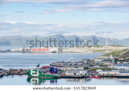 Marina, storages, gas carrier and flare stack in the harbor of Hammerfest #1417823849