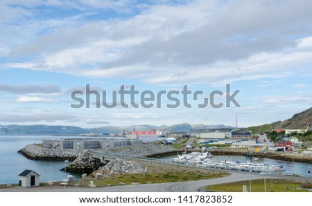 Marina, storages, gas carrier and flare stack in the harbor of Hammerfest #1417823852