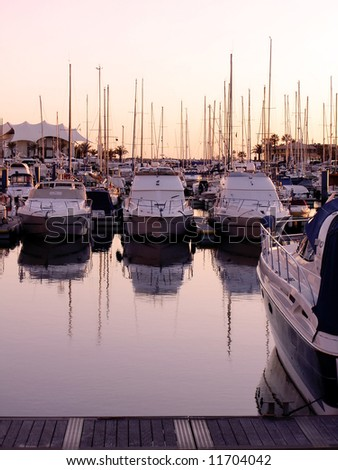 Marina view of Vilamoura near Quarteira City, Algarve, Portugal, with it's many cool boats, at sunset.