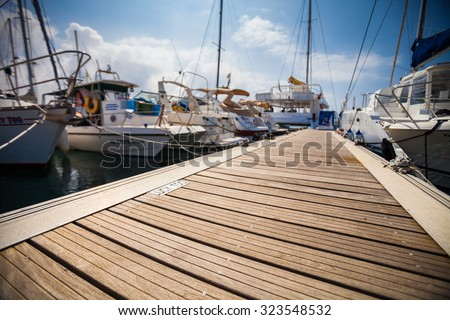 Marina with anchored boats #323548532