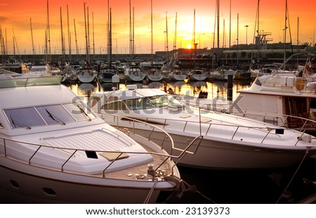 Marina with docked yachts at the end of the day