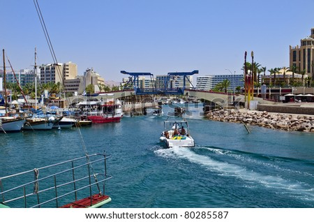Marina with docked yachts in Eilat – famous resort and recreation Israeli town located at northern part of the Aqaba gulf, Red Sea
