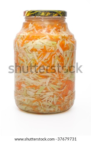 Marinated cabbage and  carrots  in a glass jar.
