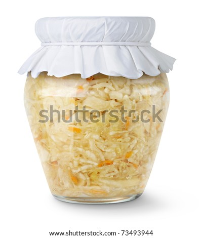 Marinated cabbage (sauerkraut) in glass jar isolated on white