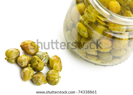 marinated capers on white background