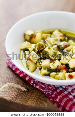 Marinated feta in olive oil, with garlic, chili and peppercorn.