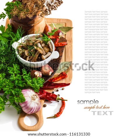 Marinated mushrooms in a cup on the background of a cutting board and spices