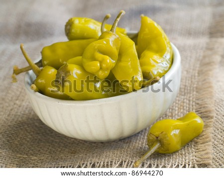 Marinated pepper in bowl with garlic, soft focus