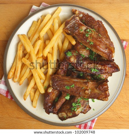 Marinated pork ribs and fries