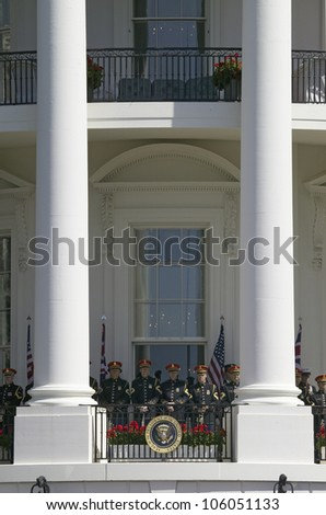 Marine Band Trumpeters standing at ease behind Presidential Seal May 7, 2007, Washington, DC