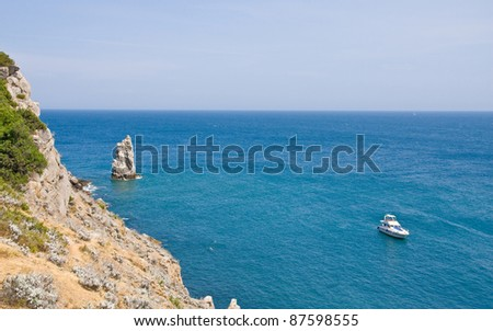 marine bay with rocks in which cutter