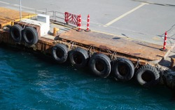 Marine berth protected by old car tires.